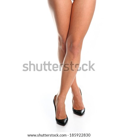 Bare legs on high heels on white background. Front view, crossed position - stock photo