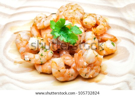 bare prawns cooked with garlic - stock photo