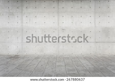 Bare Rectangle Concrete wall blocks and square cement floor textured background