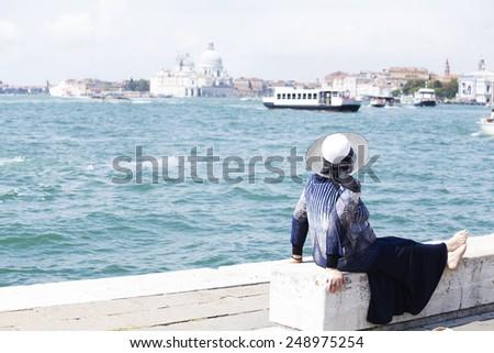 Barefoot elderly woman enjoying in Venice - stock photo