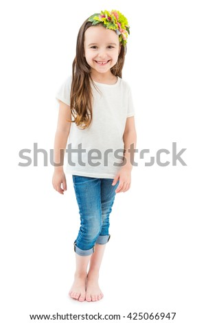 Barefoot girl in a floral headdress white t-shirt and jeans laughing funny kid. Lovely children's clothes without prints. Long hair. Happy mood. Catalog template for place your own logo or image