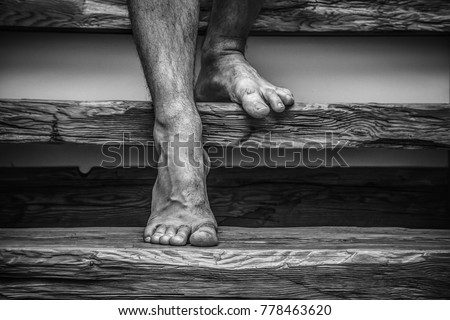 dark basement stairs. Barefoot man stepping down stairs to the basement  Scary dark atmosphere Phobia concept Basement Stairs Stock Images Royalty Free Vectors