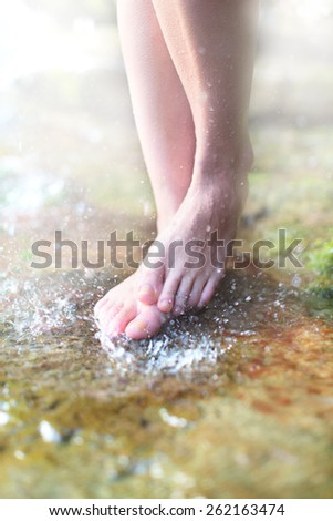 Barefoot on the water - stock photo