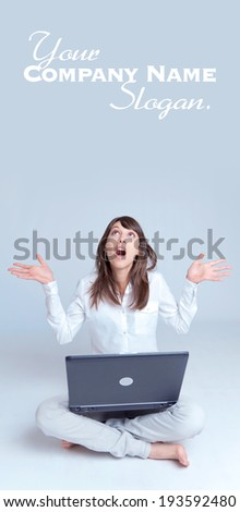 Barefoot young woman using her computer   - stock photo