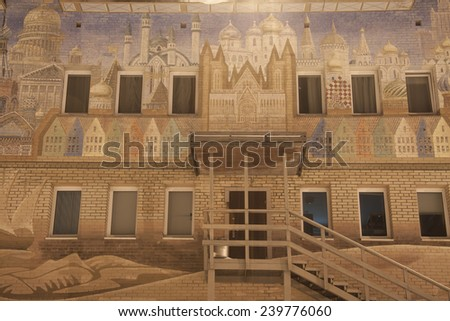 BARENTSBURG, SPITSBERGEN - November 3, 2014: Arctic. Decorative facade of the building schools and kindergartens in the Russian settlement of Barentsburg mine on Spitsbergen - stock photo