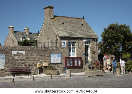 Barfleur a small French port in  the Normandy region - August 2016 - The tiny building which houses the Tourist Office on the quayside