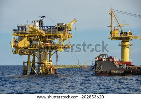 barge and tug boat in open sea,Oil and gas platform in the gulf or the sea, The world energy, Offshore oil and rig construction