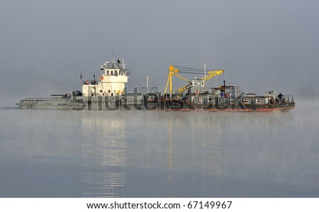 Barge in the morning fog