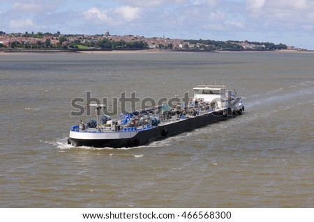 Barge moving in the waterways of Liverpool, United Kingdom.