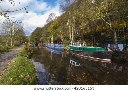 Barge on the canal in autumn England UK