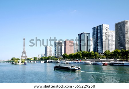 barge on the Seine and Eiffel tower, Paris, France