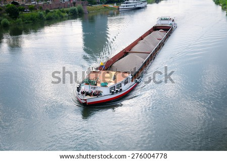 barge with cargo on river - stock photo