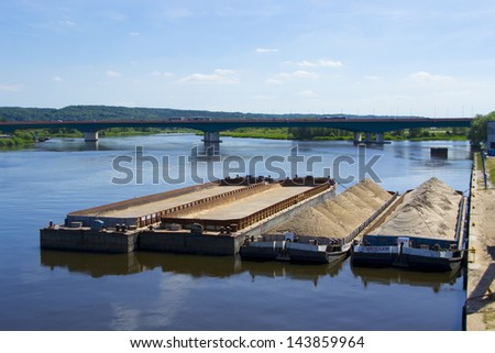 Barge with sand waiting to be unloaded