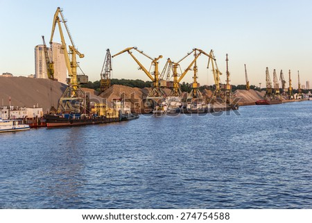 barges and cranes in the river port