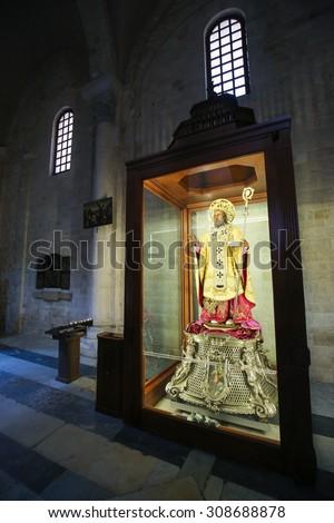 BARI, ITALY - MARCH 16, 2015: Statue of Saint Nicholas in the Basilica of Saint Nicholas, a famous pilgrimage site in Bari, Puglia, Southern Italy - stock photo