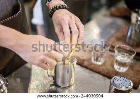 Barista combine ingredient of capochino - stock photo