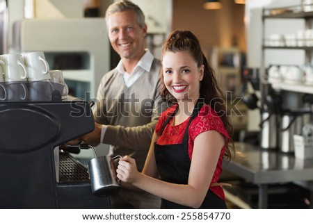 Barista making a cup of coffee at the cafe