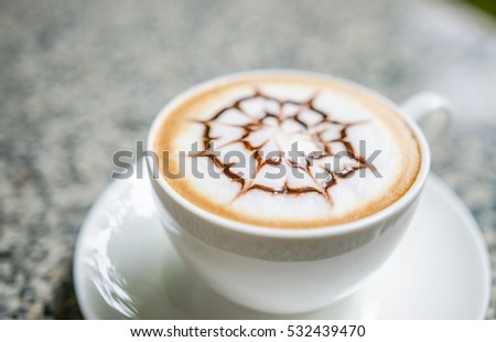 Barista making a cup of coffee soft focus image .