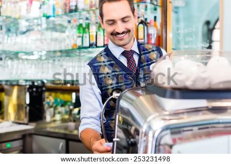 Barista preparing coffee in cafe bar using professional espresso machine - stock photo