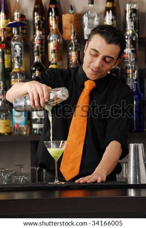 Barkeeper preparing cocktail. Bartender pouring liquor. Male bartender.