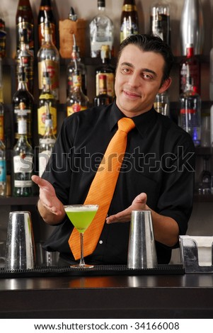 Barkeeper preparing cocktail. Male bartender. Male barkeeper. - stock photo