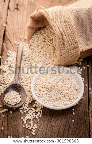 barley beans pour from sack on wood background
