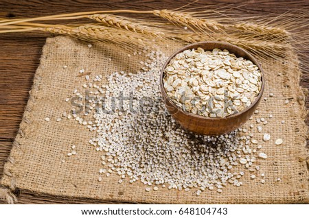 Barley Grain And Flakes In Wooden Bowl On Sackcloth Barley Grain Is Raw Material Of