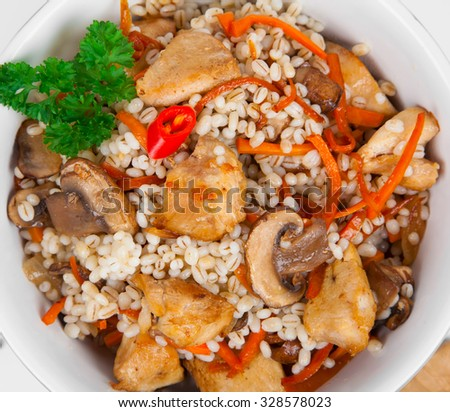 Barley porridge with, meat, mushrooms and carrots