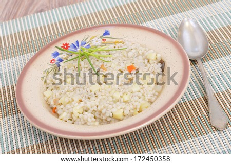 barley soup .Vegetable soup with barley - stock photo