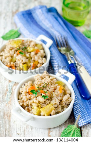 Barley stew with vegetables, selective focus - stock photo