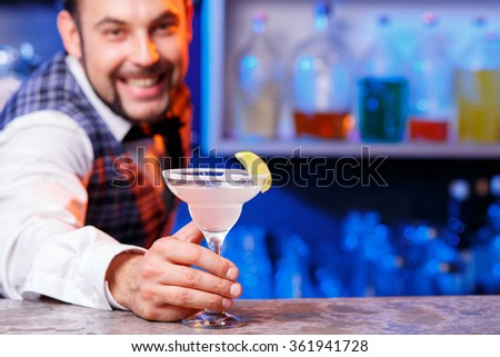 Barman at work, preparing cocktails.