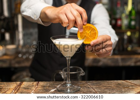 Barman at work, preparing cocktails. Preparing pina colada. concept about service and beverages. - stock photo