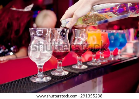 Barman  prepares exotic cocktails at the night club - stock photo