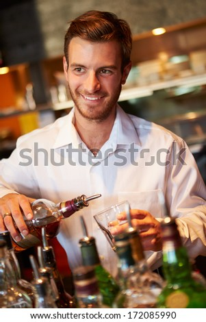 Barman Serving Drinks In Nightclub - stock photo