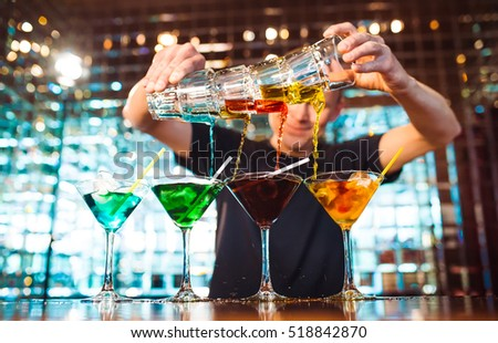 Barman show. Bartender pours alcoholic cocktails.
