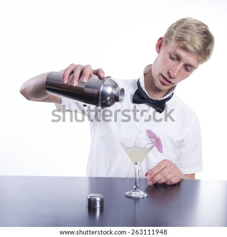 barman with cocktail over white background - stock photo