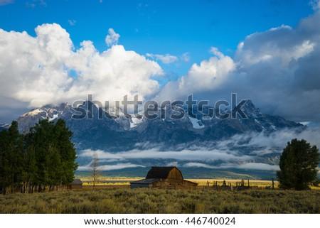 Barn and fields of grass and sagebrush, Grand Teton National Park, Wyoming - stock photo