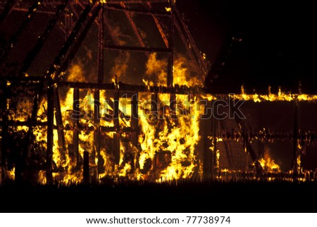 Barn burning in the middle of the night - stock photo