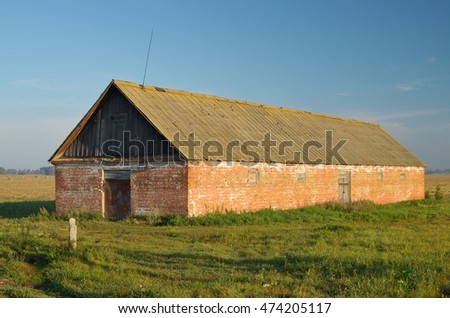 Barn for storage of grain on the outskirts of the village.