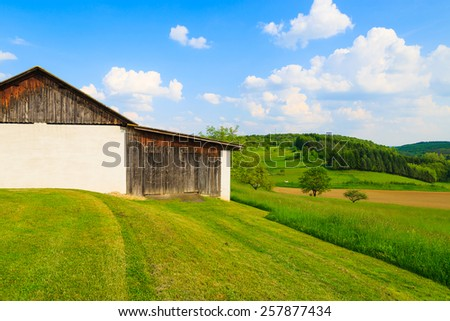 Barn on green farming field in countryside spring landscape, Burgenland, Austria - stock photo