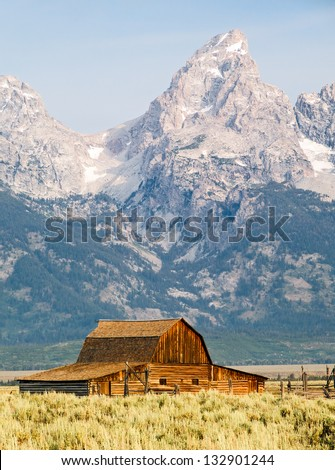 Barn on Mormon Row with peaks of the Teton Range behind. Grand Teton National Park, Wyoming, USA - stock photo