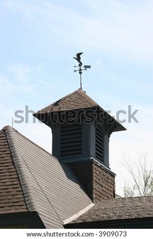 Barn roof with weather vane. - stock photo