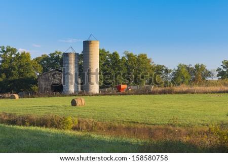 Barn, Silos, and Wagon - stock photo