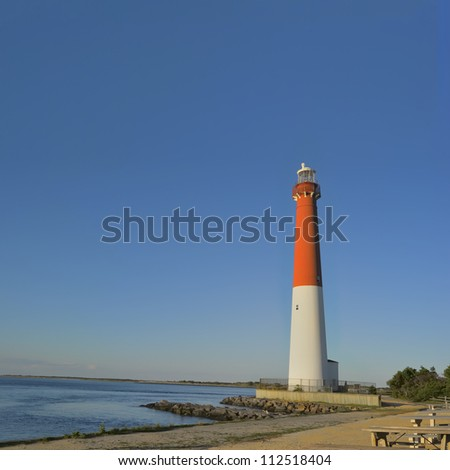 Barnegat Lighthouse located in Barnegat Lighthouse State Park in the town of Barnegat Light, Long Beach Island, New Jersey. The 165 foot tall red and white tower marks the 40th parallel. - stock photo