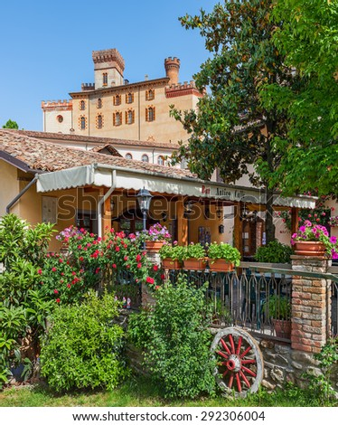 BAROLO, ITALY - MAY 14, 2015: Restaurant and old castle of Barolo (Castello Falletti) - world famous wine town and popular tourists destination of hilly Langhe area in Piedmont, Italy. - stock photo