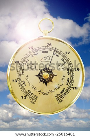 Barometer with cloudy sky in the background - stock photo