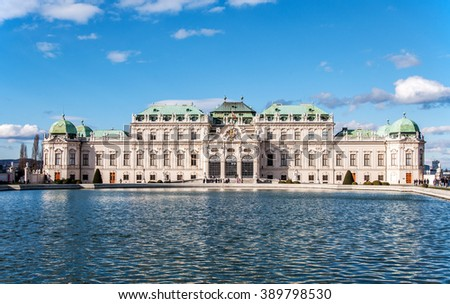 Baroque Belvedere palace in Vienna, Austria, with the pond in sunset light - stock photo