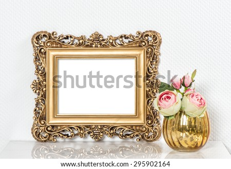 Baroque golden picture frame and rose flowers. Vintage style mockup with space for your picture or text - stock photo