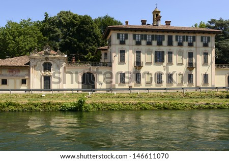 baroque palace on canal, Cassinetta di Lugagnano; view of old palace on artificial historic canal, shot in summer bright light