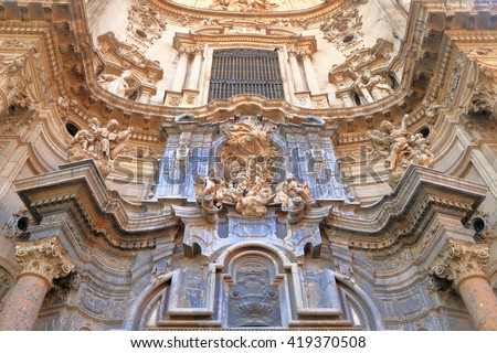 Baroque sculptures decorate the facade of the Cathedral Church of Saint Mary in Murcia, Spain - stock photo